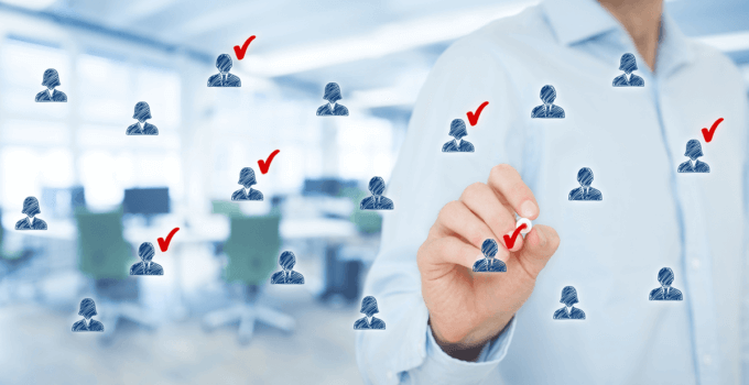 Man-Selecting-Candidate-Icons-from-Group-Floating-In-Front-of-Him-with-Red-Check-Marks-680x350